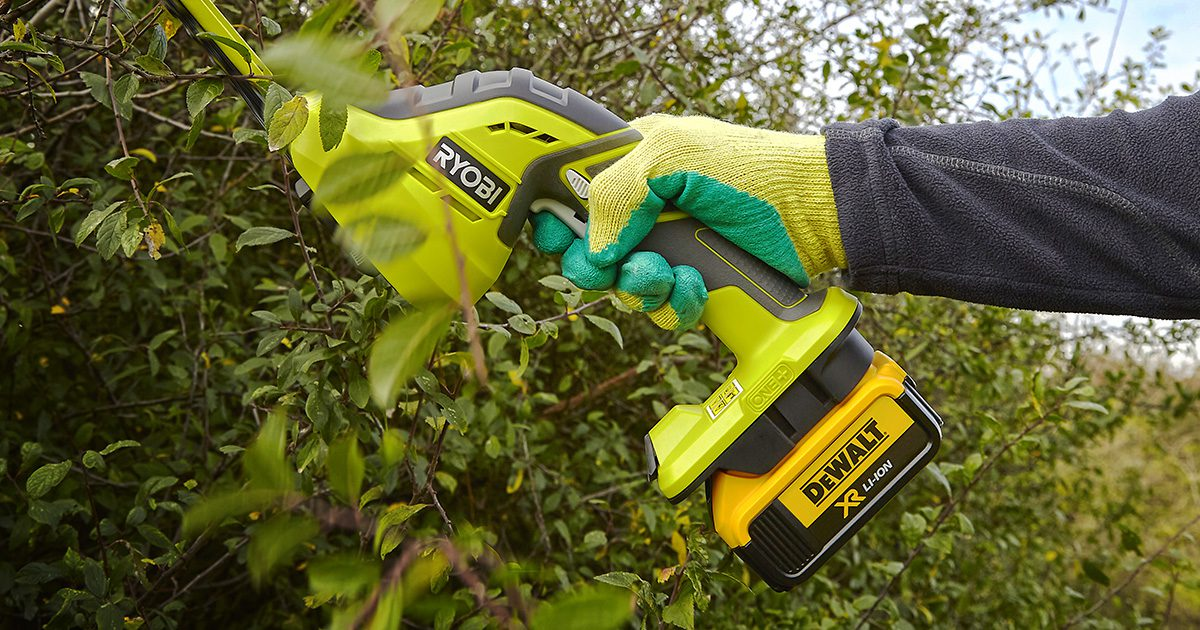 Ryobi One+ hedge trimmer with DeWalt battery