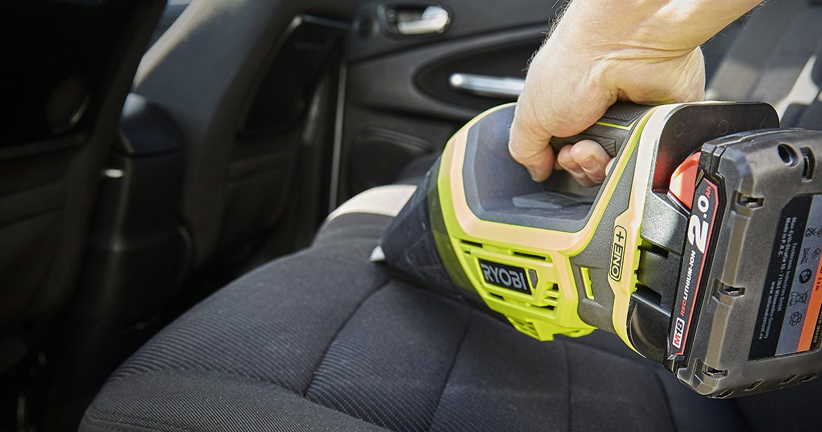 Ryobi One+ cordless vac cleaning car seat