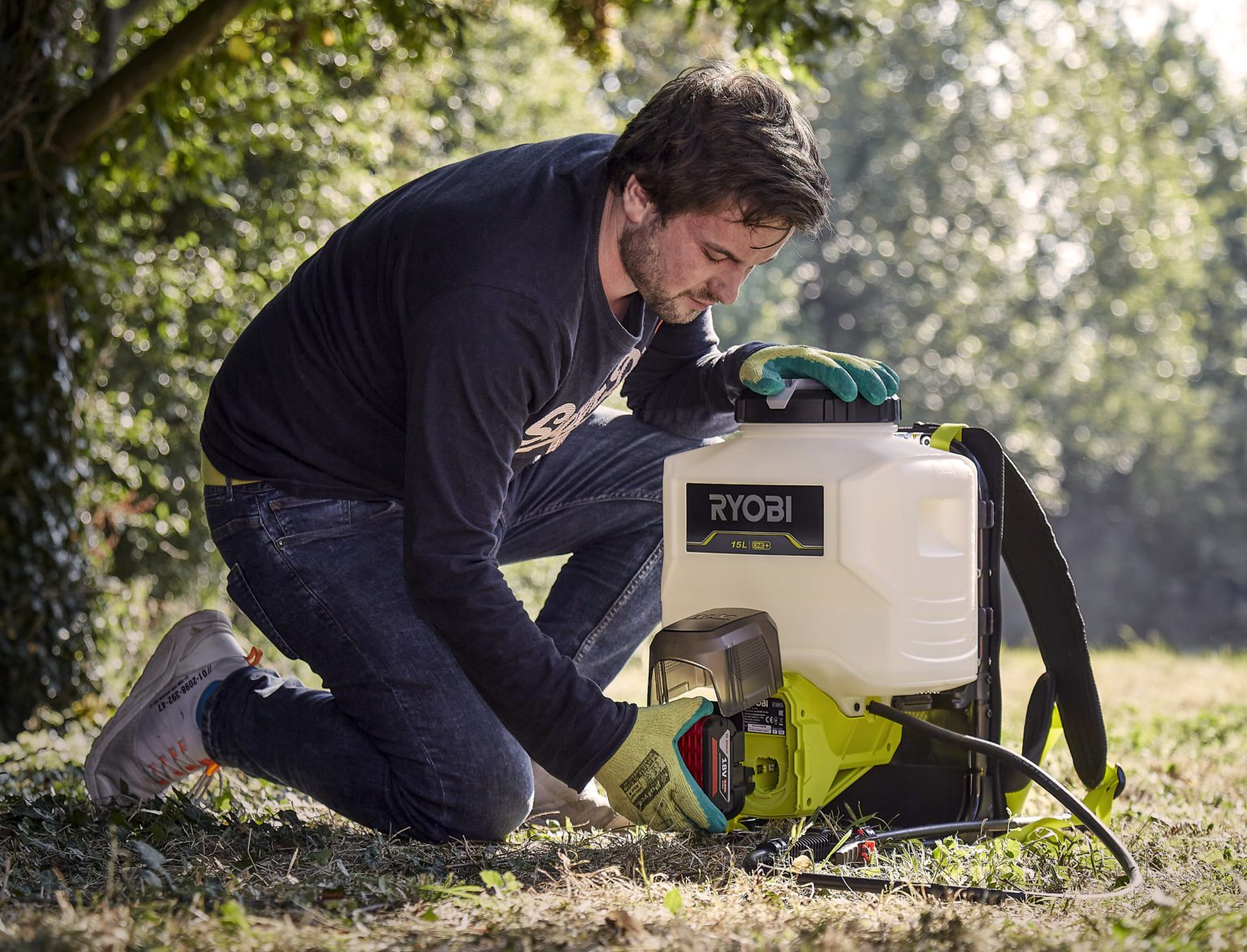 Inserting Badaptor into weed sprayer