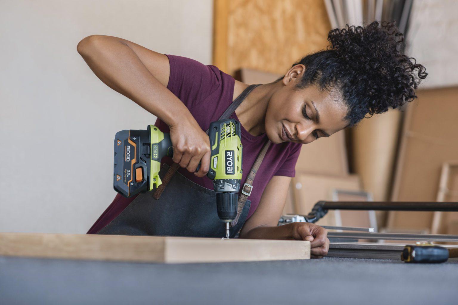 Woman doing DIY with Ryobi drill